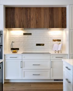 white kitchen with walnut accents